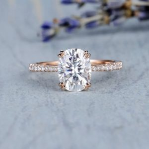 Oval diamond petite engagement ring, double claw grain set