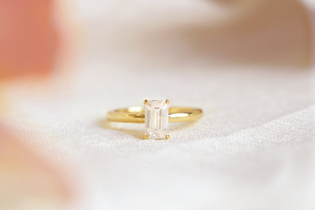 Yellow gold solitaire with emerald cut diamond